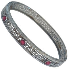 Art Deco Rhodium plated bracelet bangle with ruby paste stones