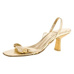 a99ff53f8 Gucci Gold Metallic Leather Sylvia Crossover Mules Size 37 at 1stdibs