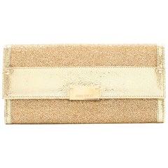 Jimmy Choo gold glitter clutch