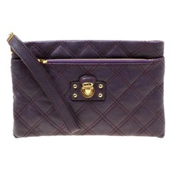 aad207e49bc2 Marc Jacobs Purple Quilted Leather Wristlet Clutch. MARC JACOBS Beige   Gold  Quilted Leather Lock Clutch Handbag