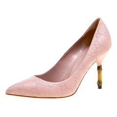 93cdc2be228 Gucci Pale Pink Guccissima Leather Kristen Bamboo Heel Pumps Size 35.5