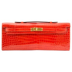 *Never Used* Hermès Kelly Cut pochette crocodile porosus lisse orange