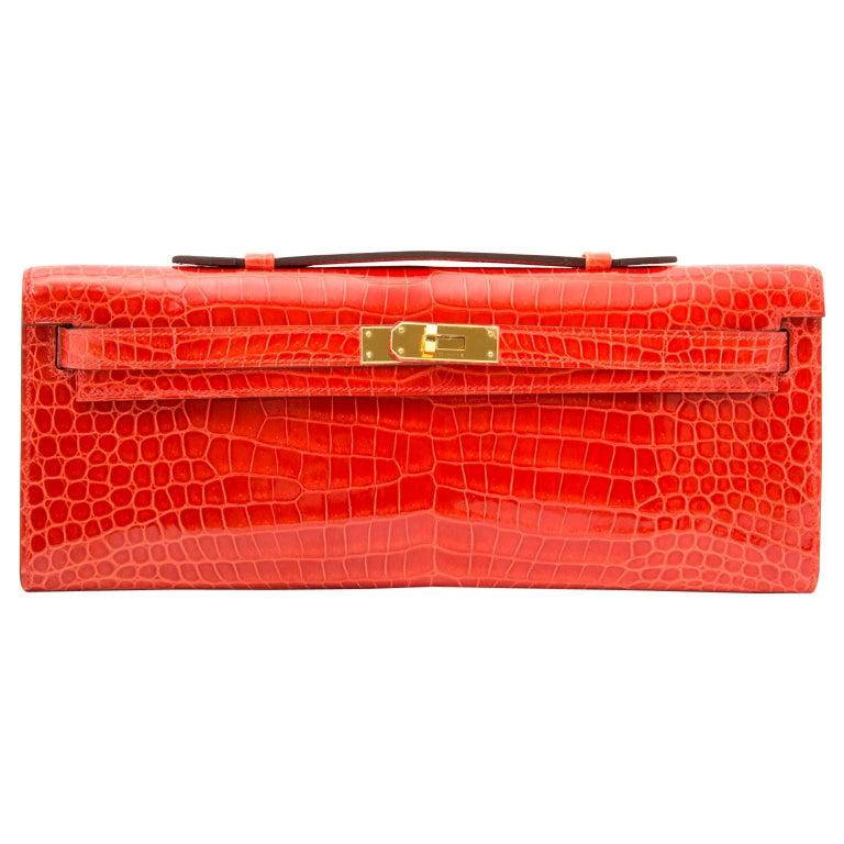 *Never Used* Hermès Kelly Cut pochette crocodile porosus lisse orange  For Sale