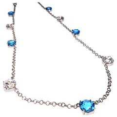 Elegant necklace of Blue Topaz and White Cambodian Zircon gemstones
