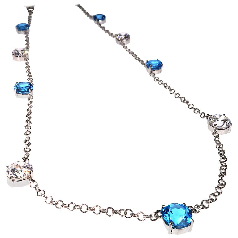 Elegant necklace of Blue Topaz and White Cambodian Zircon gemstones For Sale