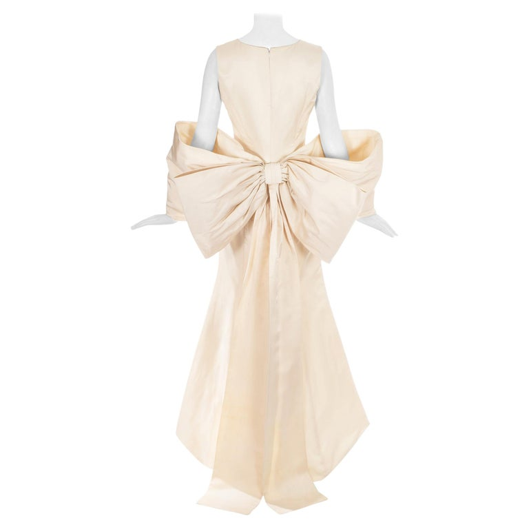 Dolce & Gabbana ivory silk fishtail wedding dress with large bow, c. 1990s For Sale