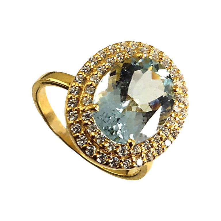 Glittering oval Aquamarine with Zircon Halo Cocktail Ring For Sale