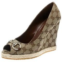 a72eb0284d4 Gucci Beige GG Canvas Charlotte Horsebit Peep Toe Wedge Pumps Size 39