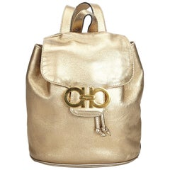 Ferragamo Gold  Leather Metallic Gancini Drawstring Backpack Italy