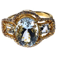 Sparkling Three stone Aquamarine Dinner ring with Zircons