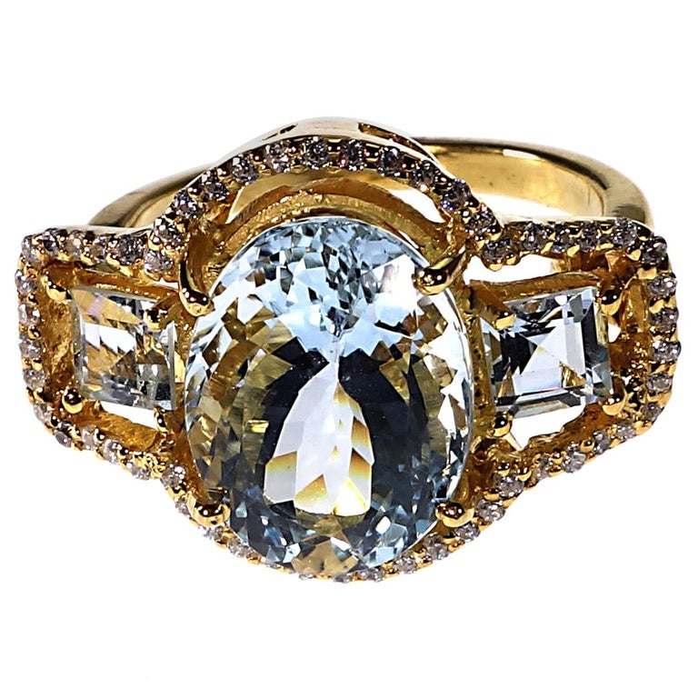 Sparkling Three stone Aquamarine Dinner ring with Zircons For Sale