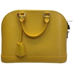 Louis Vuitton Yellow Alma Epi Handbag