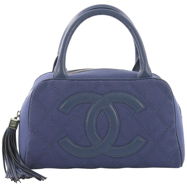 2ff5c9d4f2f9 Chanel CC Tassel Bowler Bag Quilted Canvas Small For Sale at 1stdibs