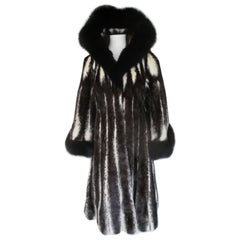 Extravagant cross mink fox fur coat