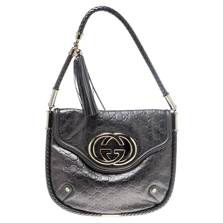20797f683e2b2e Gucci Metallic Grey Leather Medium Britt Tassel Hobo For Sale at 1stdibs