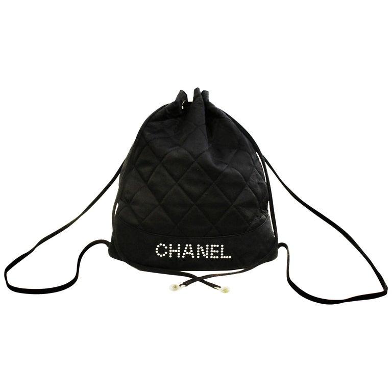 Chanel Black Satin Mini Drawstring Back Pack Bag by 1 Stdibs