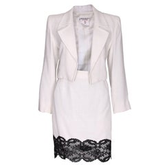 A vintage 1990s white with black lace trim Yves Saint Laurent Skirt Suit