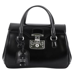 Gucci Lady Lock Satchel Leather Small, crafted in black glazed leather