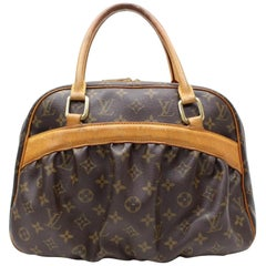 Louis Vuitton Mizi Monogram 866533 Brown Coated Canvas Satchel
