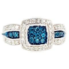 Blue Diamond and White Diamond Ring
