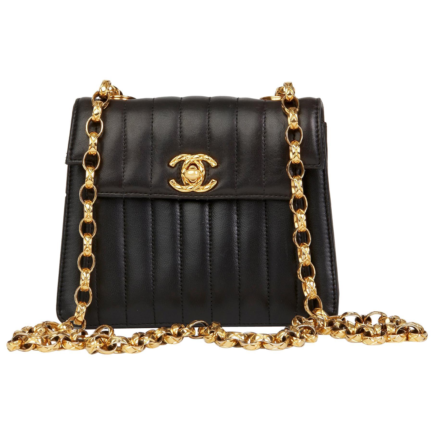 6740b622c7c7 1991 Chanel Black Vertical Quilted Lambskin Vintage Mini Flap Bag at 1stdibs