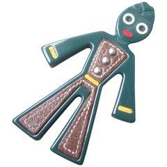 Prada Whimsical Figural Resin Leather Trim Bellhop Brooch circa 1990s