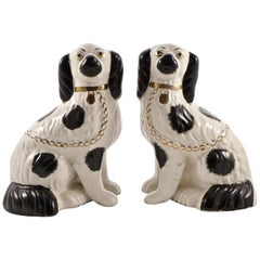 Pair of Staffordshire Hand Painted Black and White Pottery Dog Figurines
