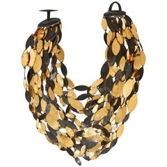 Monies oxidized gold and black metal multi strand necklace