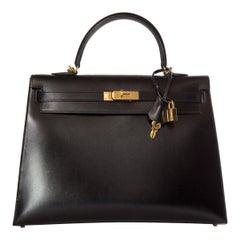 HERMÈS  Black Kelly 35cm Sellier Swift Leather Handle Bag $15,995.95