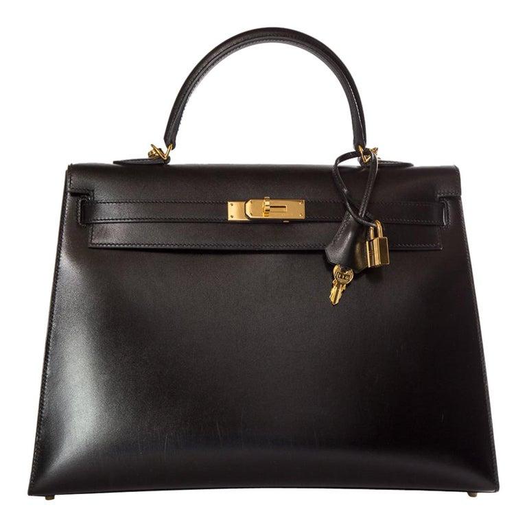HERMÈS  Black Kelly 35cm Sellier Swift Leather Handle Bag $15,995.95 For Sale