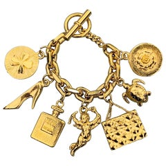 CHANEL Vintage Gold Tone Angel Coco Purse Pump Perfume Charm Bracelet