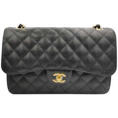 Chanel Jumbo Black Quilted Caviar Maxi Classic Double Flap Gold Tone Bag A58600