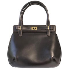 1970s Gucci Brown Leather Top Handle Bag