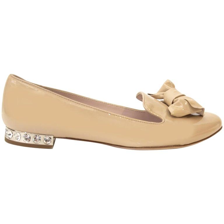 Miu Miu beige patent leather jeweled-heel flats, offered by Labellov
