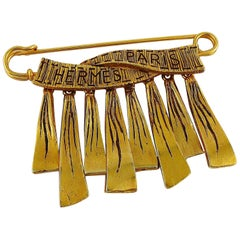 Hermes Vintage Gold Toned Safety Pin Ribbon Charms Brooch