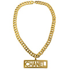 CHANEL Vintage Gold Tone Metal Curb Chain Logo Nameplate Cutout Pendant Necklace