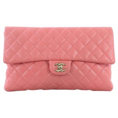 1bd13297125942 Chanel O Case Clutch Quilted Lambskin Large at 1stdibs
