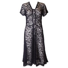 A vintage 1930s -1940s navy blue floral sheer lace / mesh day dress.