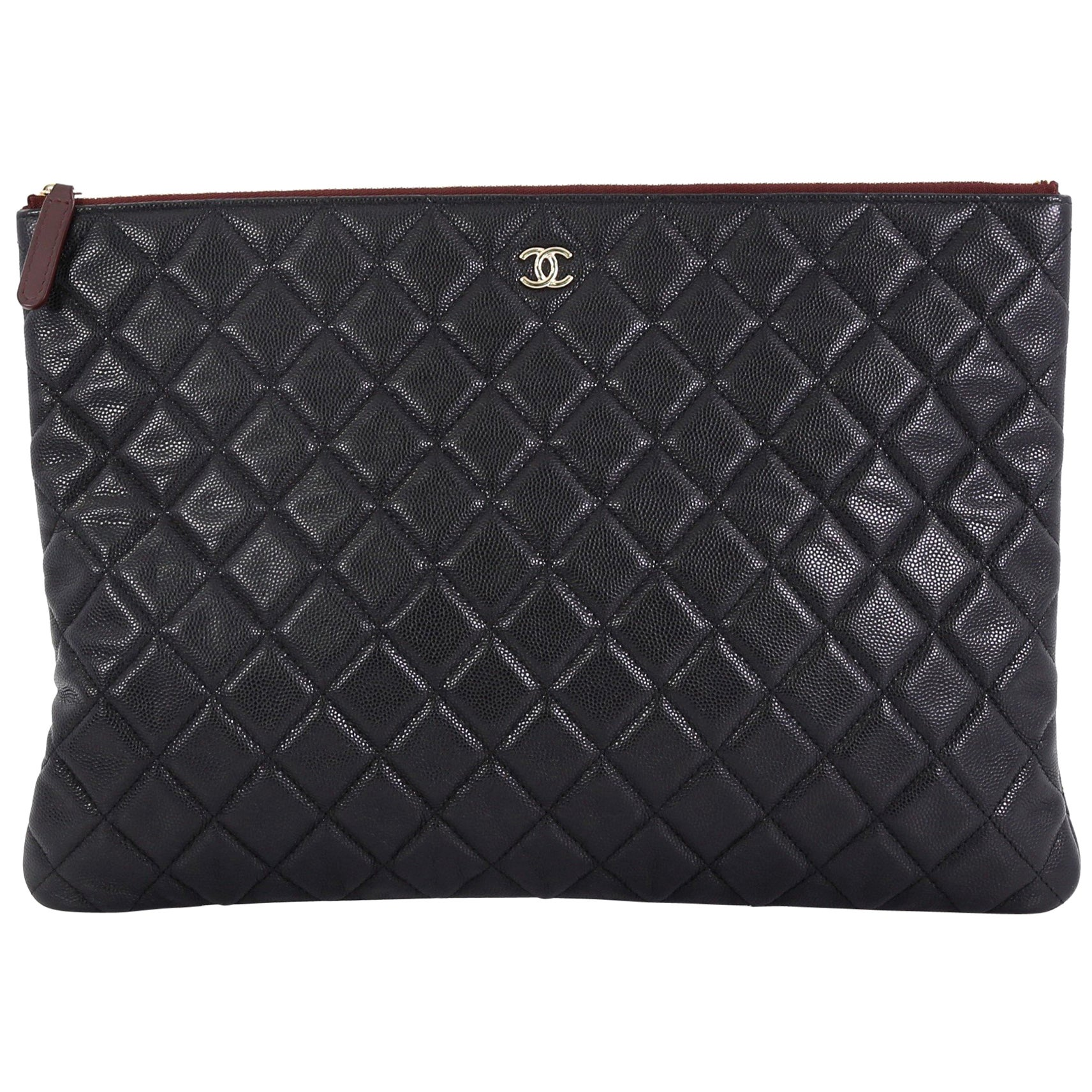 5a05fb9f04b780 Chanel O Case Clutch Quilted Caviar Large at 1stdibs