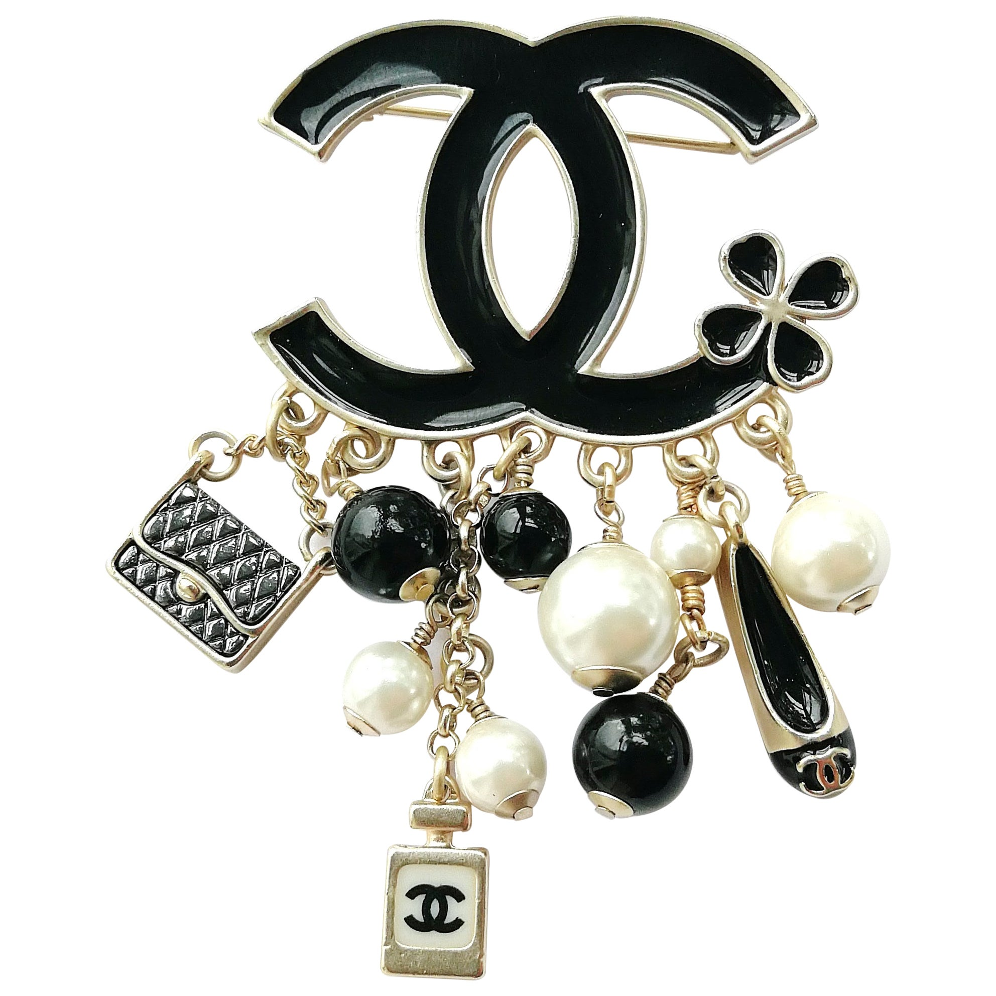 45aa39eeb Large black enamelled and silvered metal Double C 'charm' brooch, Chanel,  2014 at 1stdibs