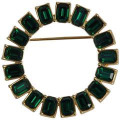 """Monet Circular Gilded Gold with """"Emerald"""" Rhinestone Brooch"""