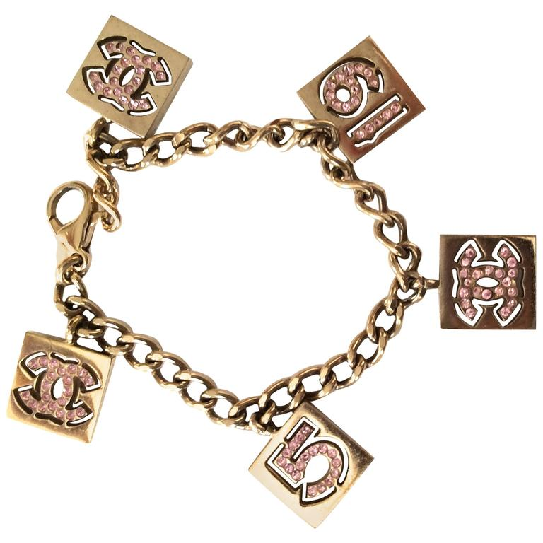 Vintage Chanel Gold Tone with Pink Rhinestone Charm Bracelet For Sale