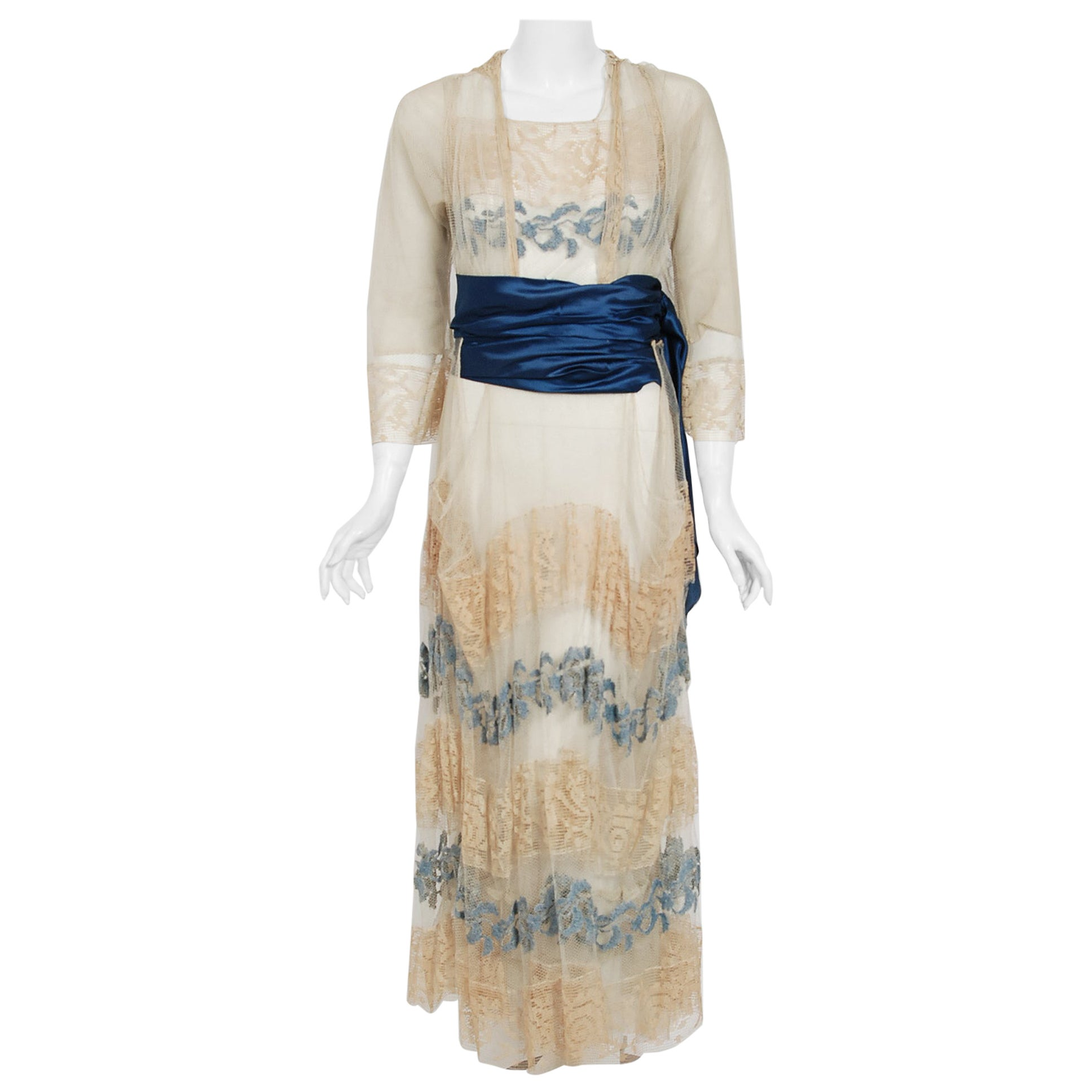 1910's Julius Garfinckel Couture Beige Embroidered Net-Lace Blue Silk Sash Dress