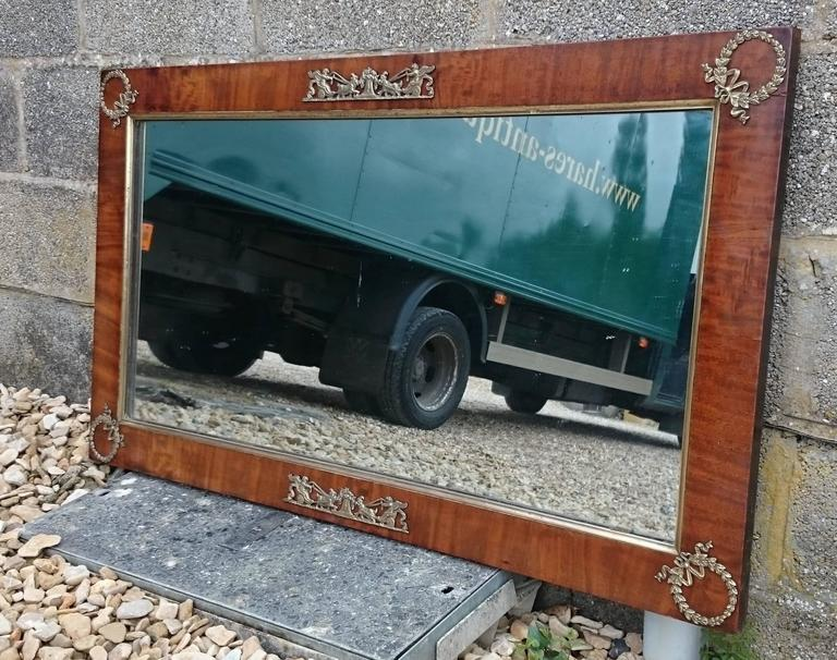 Mahogany and ormulu mounted antique mirror, this mirror is a particularly fine colour and is made of a really good cut of timber.   French, circa 1830   49½