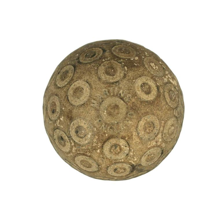 Martins 'Zodiac' golf Ball. A good example of a 'Zodiac' rubber core golf ball with an unusual pattern. The pattern consists of raised studs within circles. The golf ball is manufactured by Martins, England. The Martins-Birmingham Ltd. was one of