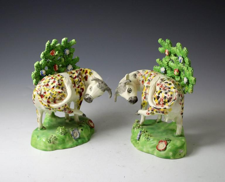 English Staffordshire Pottery Figures of Cows on Bases with Bocage Pearlware Glaze For Sale