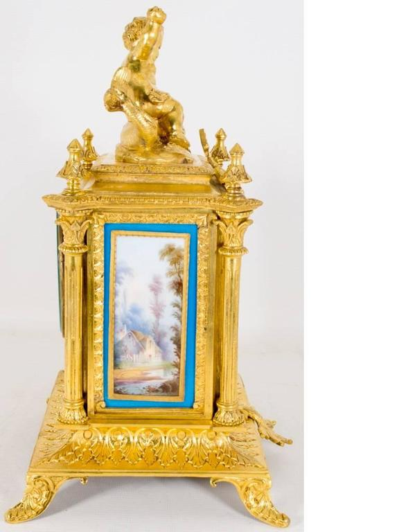 This is a lovely antique French ormolu, gilt bronze, mantel clock with a profusion of Roue Blue porcelain panels in the Sevres manner, circa 1870 in date.   The movement carries the Paris retailers and the clock maker mark HP & Co and what we