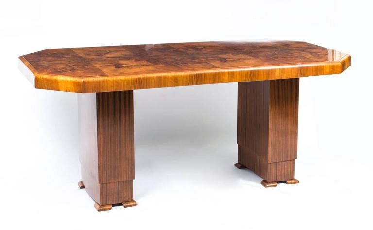 A truly stunning antique Art Deco burr walnut dining table, circa 1930 in date, with the original set of six matching antique Art Deco burr walnut chairs.   It is quite rare to find an original Art Deco period 1930s walnut dining set.   This set