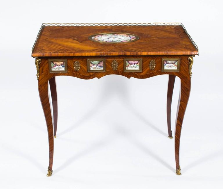 This fine piece is an Antique French Writing Table or Side Table with Porcelain Plaques and which dates from around 1780.  This late 18th century antique French kingwood writing table (or side table) has been beautifully decorated with lovely ormolu