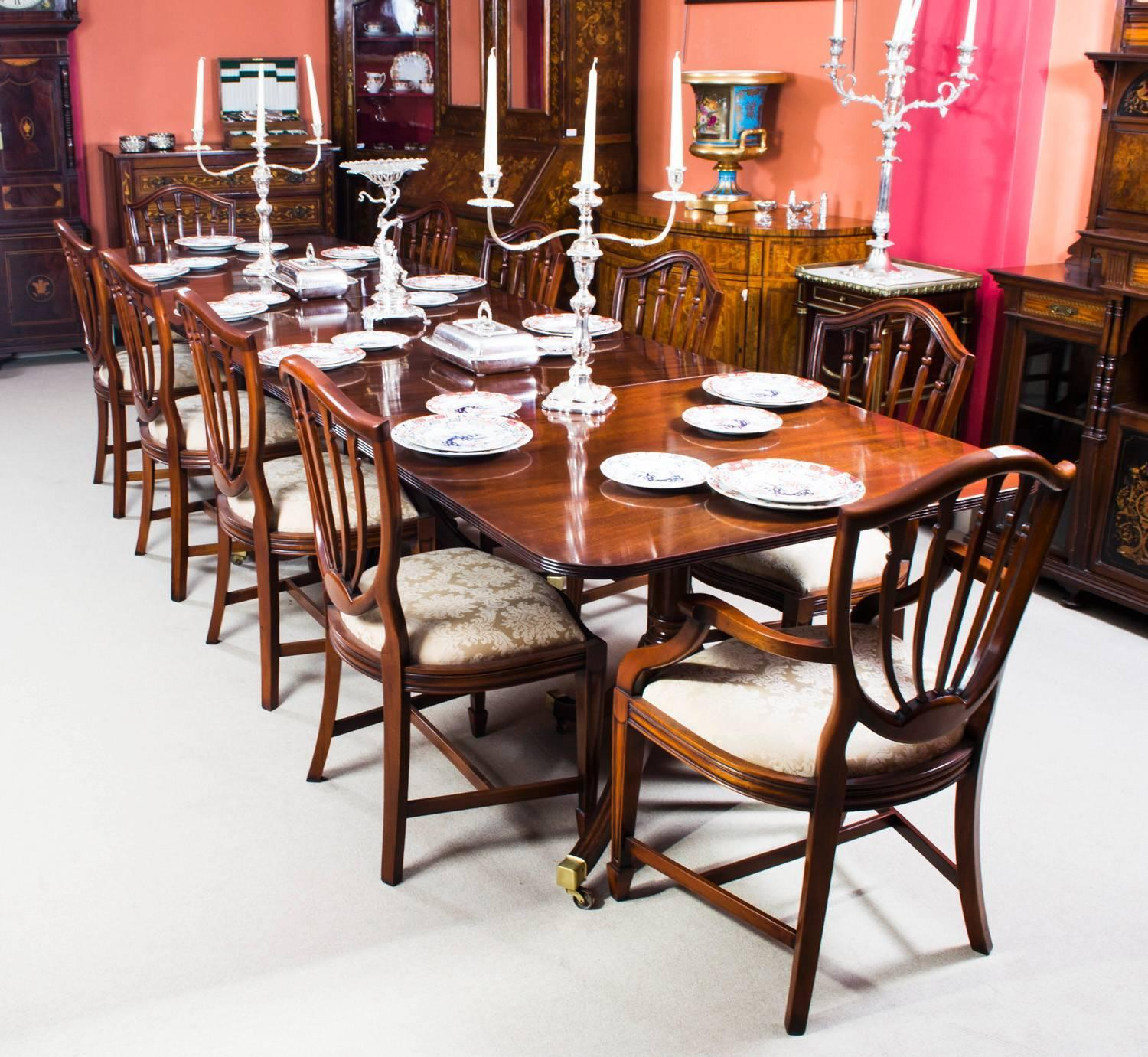 Antique Regency Three-Pillar Dining Table And Ten Chairs